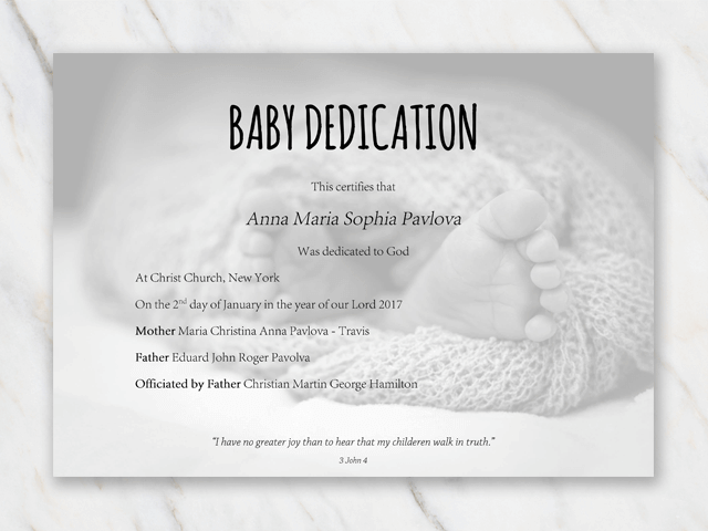 Baby dedication certificate babyfeet wrapped in blanker on background