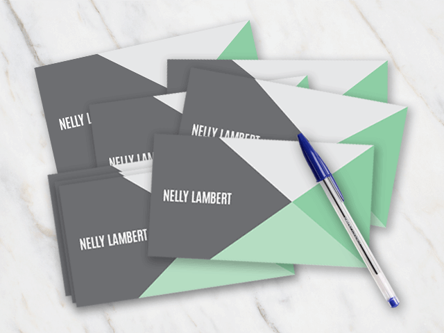 Business card with green white and grey colors