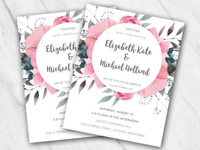 Wedding invitation with pink flowers and green leaves